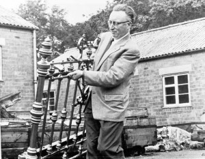 Beamish's  first Director, Frank Atkinson, carries a bed end through Brancepeth Camp, 1966