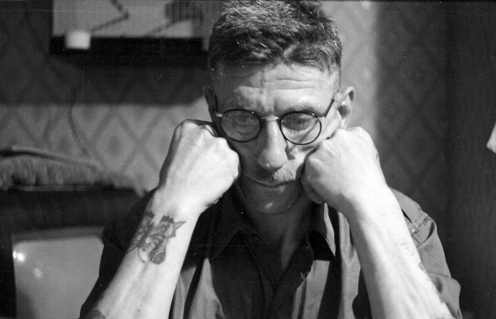 81586 - Portrait of Billy Longstaff, a miner at Sherburn Hill Colliery, model engineer and amateur photographer who lived at 32 The Crescent, Sherburn Village, c1955. He has a butterfly tattoo on his forearm.