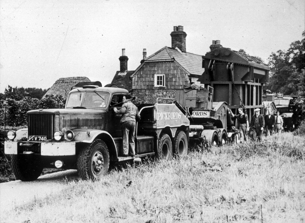 Sadly the photographs are mostly of unknown date or location, and this image gives little clue as to either. It ably demonstrates though the size and weight of a typical Parson's load - requiring two tractor units to move and presumably a route avoiding low bridges...