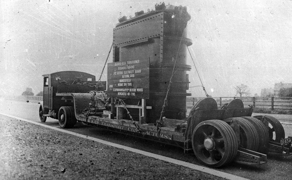 Another undated view, though likely to be pre-WW2 based on the vehicle, owned by Currie (?) and Co, Transport Contractors, Newcastle. Handily, the load tells us exactly what it is and where it is going!  '15,000 K.V.A. Transformer 33,000/6,600 For Central Electricity Board National Grid Huddersfield Weight 26 Tons From C.A. Parsons & Co. Ltd. Heaton Works Newcastle-on-Tyne'