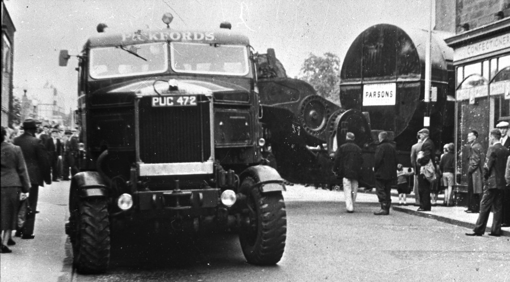 Quite a change of pace from furniture removals - a Pickfords Scammell lorry picks its way through an unknown location in the early 1960s while  transporting a generator to Kincardine Power Station in Fife, Scotland. The station opened in 1962.