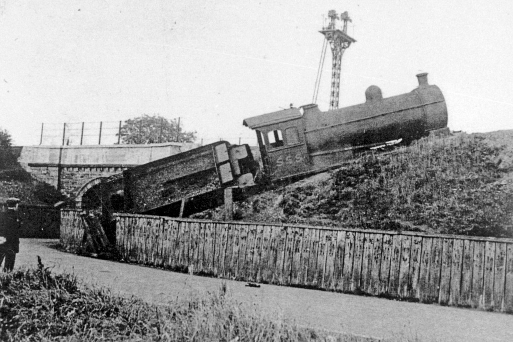 65654 - This view is undated but It looks like loco' no. 555 (of the North Eastern Railway class J26) has over-run buffer stops on the Boldon Colliery railway and slid down an embankment, barely missing a road. Despite appearances the engine was salvaged and ran until 1960, when it was scrapped at Darlington works.