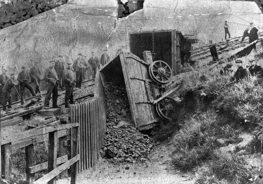 23512 - This 1898 photo shows two Chaldron wagons which have come to grief at the foot of Blackhouse Incline on the Pelaw Main Railway near Birtley after the haulage rope broke.