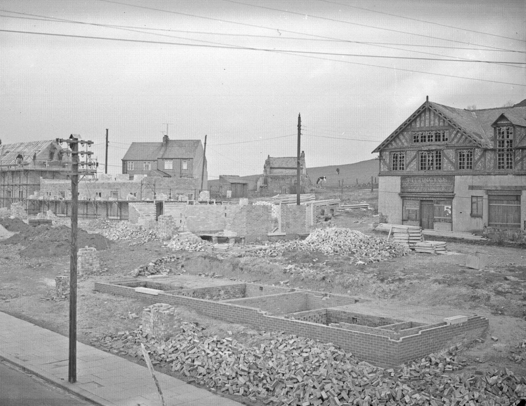 72524 - General view of new housing being built at Pittington in front of the old Co-op store, 20th March 1959